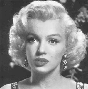 a biography and life work of norma jeane baker marilyn monroe an american actress Marilyn monroe's life began as a neglected girl who then became a marilyn monroe, an american model turned actress norma jeane mortenson, norma jeane baker.
